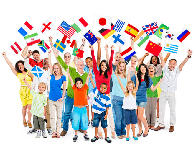 Large group of multi-ethnic diverse mixed age people celebrating while holding flags.